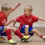 Stirker Academy Mini Strikers using their footballs to balance