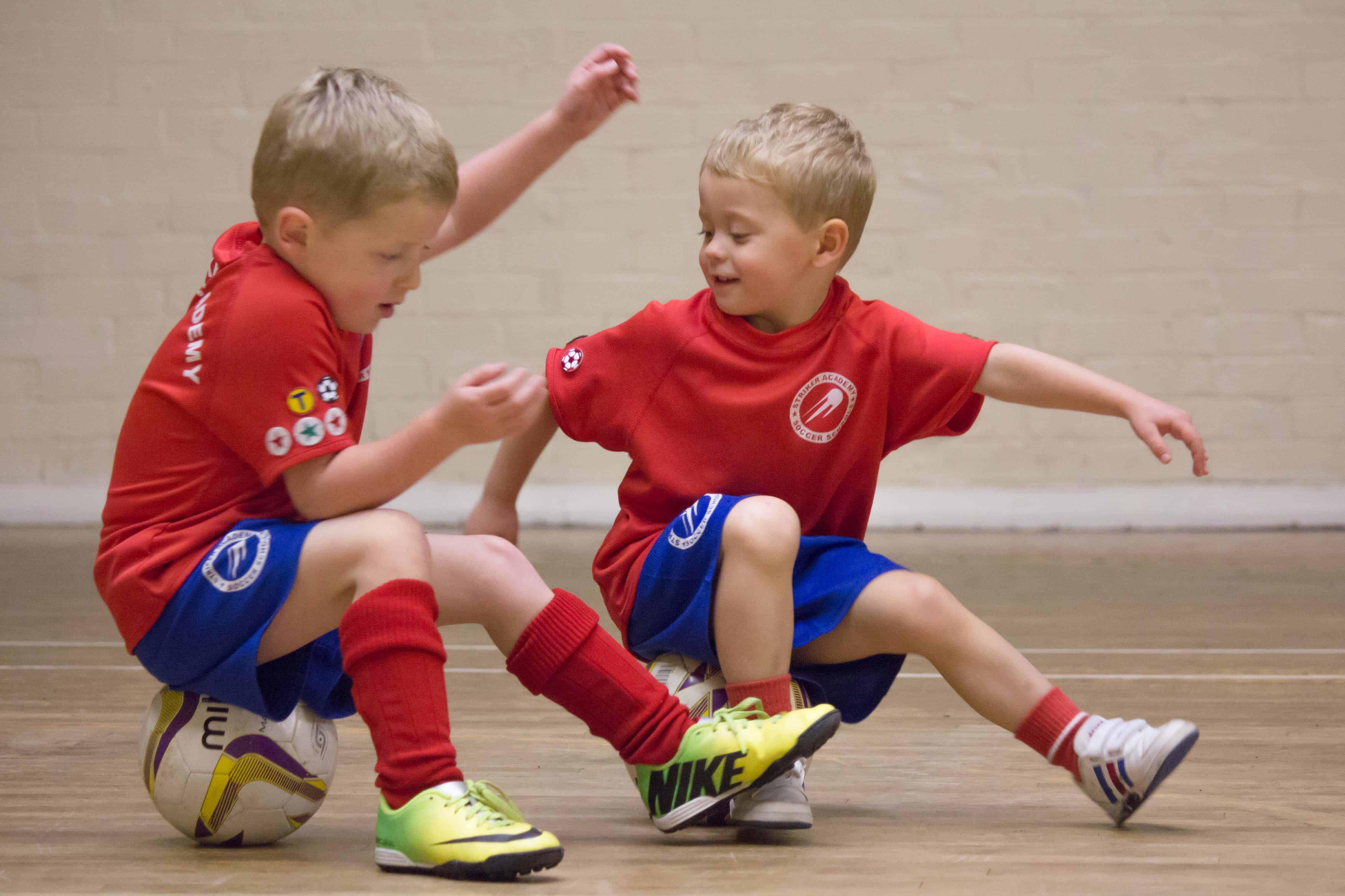 Stirker Academy Mini Strikers using their footballs to balance