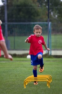 Stirker Academy player going over speed hurdles