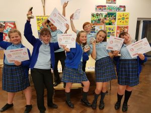 Sports Leaders showing off their certificates and trophies