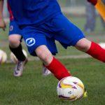 Stirker Academy player kicking a football